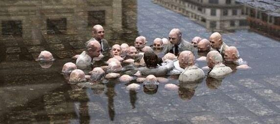 Politicians-discussing-global-warming.-Sculpture-by-Issac-Cordal.